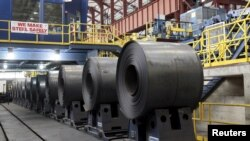 FILE - Rolled steel is seen after being treated on the pickle line at the Severstal steel mill in Dearborn, Michigan, June 21, 2012.