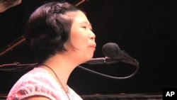 Concert pianist, Lee Hee-ah, was born in South Korea with severe physical impairments, but her disabilities have not stopped her from achieving her goals