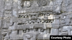 Stone monuments like this stucco frieze in Caracol, Belize, document Maya battles, births and burials. (Photo image of Douglas Kennett, Penn State)