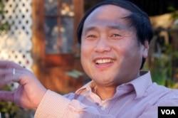 中国民主党全国委员会主席王军涛(2013年12月25日,美国之音国符拍摄)