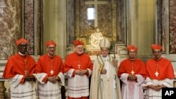 Pope Francis, center, poses in front of Michelangelo Buonarroti's Pieta' (The Pity) marble statue (AD 1499), with new Cardinals, from left, Jean Zerbo, Archbishop of Bamako, Malí, Juan José Omella, Archbishop of Barcelona Spain, Anders Arborelius, Bishop of Stockholm, Sweden, Louis-Marie Ling Mangkhanekhoun, Apostolic Vicary of Pakse, Laos, and Gregorio Rosa Chávez, Auxiliary of the dioceses of San Salvador, El Salvador, after the ceremony of their elevation in St. Peter's Basilica at the Vatican, June 28, 2017.