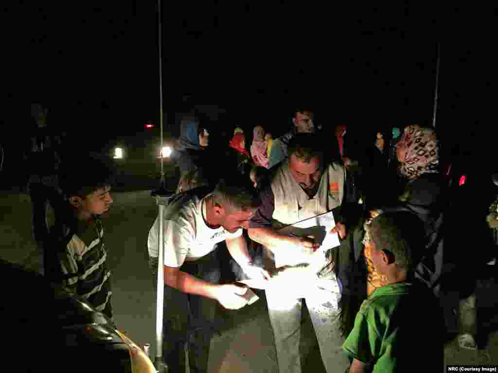 Newly arrived Iraqis from Fallujah in the early morning of 25 May 2016, being received by NRC staff.