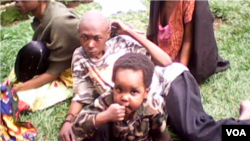 A captured jihadist ADF combatant and child. (Yassin Kombi/VOA)