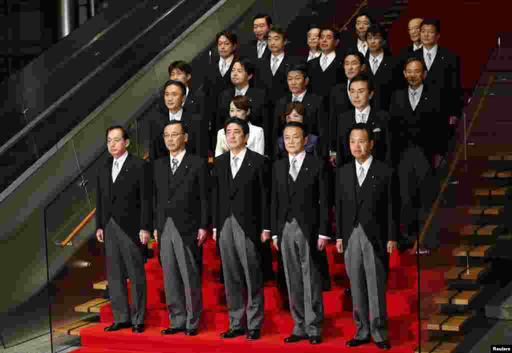 New Japanese Prime Minister Shinzo Abe (front C) and his cabinet ministers pose for a photo after their first cabinet meeting at Abe's official residence in Tokyo, December 26, 2012.