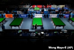 Competitors are seen playing in the billards event at the Asian Games in Guangzhou, China, 2010. (AP Photo/Wong Maye-E)