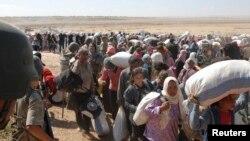 Exode de Kurdes syriens fuyant l'Etat islamique (Reuters)