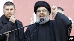 Hezbollah leader Sheik Hassan Nasrallah speaks to the crowd.