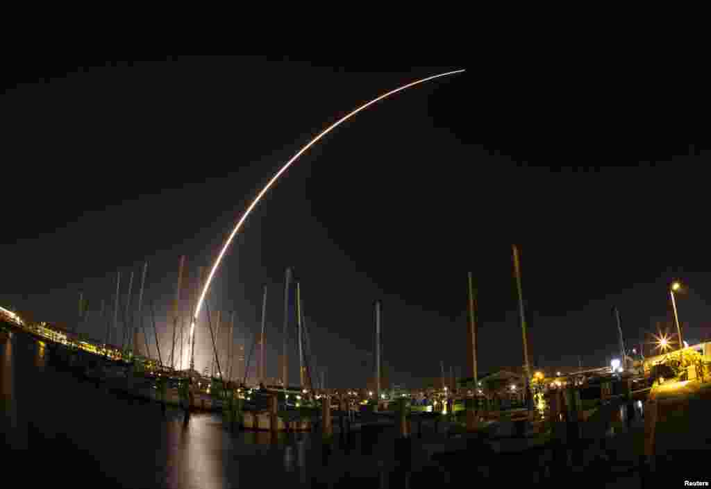 A view of the Delta IV rocket streaking across the sky after launching from Cape Canaveral Air Force Station is seen from Port Canaveral, Florida, Feb. 20, 2014.