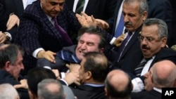 Legislators from Prime Minister Erdogan's ruling party and main opposition Republican People's Party brawl during tense all-night debate, Ankara, Feb. 15, 2014.