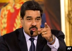 FILE - Venezuelan President Nicolas Maduro, shown in April, promises a harsh response to any coup attempt.