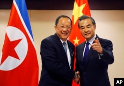 N. Korean Foreign Minister Ri Yong Ho, left, is greeted by his Chinese counterpart Wang Yi prior to their bilateral meeting on the sidelines of the 50th ASEAN Foreign Ministers' Meeting and its Dialogue Partners, Aug. 6, 2017 in suburban Pasay city, south