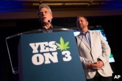 Jimmy Gould, co-founder of Responsible Ohio, a pro-marijuana legalization group, speaks to the crowd after a concession speech delivered by executive director Ian James, right, at an election night event at the Le Meridien hotel, Nov. 3, 2015.