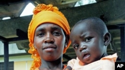 A Rwandan woman holds her child, who is recovering from a cleft-palate surgery performed during a mission by South Africa based Operation Smile, in Kigali, Rwanda, March 22, 2012.