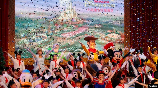 FILE- Dancers perform during the groundbreaking ceremony of Shanghai Disneyland in Pudong, China, April 8, 2011.