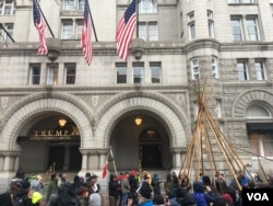 Protesters set up a tepee outside the Trump Hotel (E. Sarai/VOA)