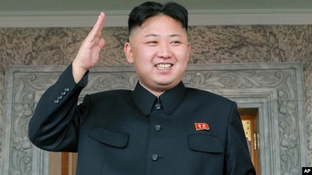 North Korean leader Kim Jong Un watches a military parade held to celebrate the centenary of the birth of the North's founder Kim Il Sung, in Pyongyang on April 15,