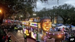 "The Officer's Float rolls down Napoleon Avenue as the 1,600 men of Bacchus present their 32-float Mardi Gras parade entitled ""Starring Louisiana"" on the Uptown route in New Orleans on Sunday, March 3, 2019. (Michael DeMocker/The Times-Picayune via AP)"