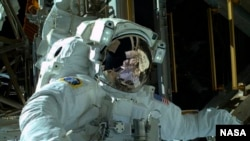 Astronaut Mike Hopkins is seen during a spacewalk in an image from NASA.