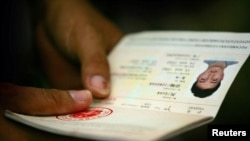 Man holds Chinese passport (2006 file photo)