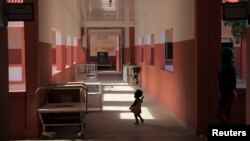 A toddler runs through Chiulo Hospital in Cunene province, Angola, Feb. 24, 2018.