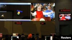 ISRO scientists and engineers watch Prime Minister Narendra Modi.