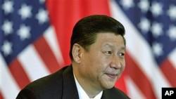 中國國家副主席習近平和美國副總統拜登(不在圖內)於去年8月19日出席在北京飯店舉行的美中貿易領袖會議。