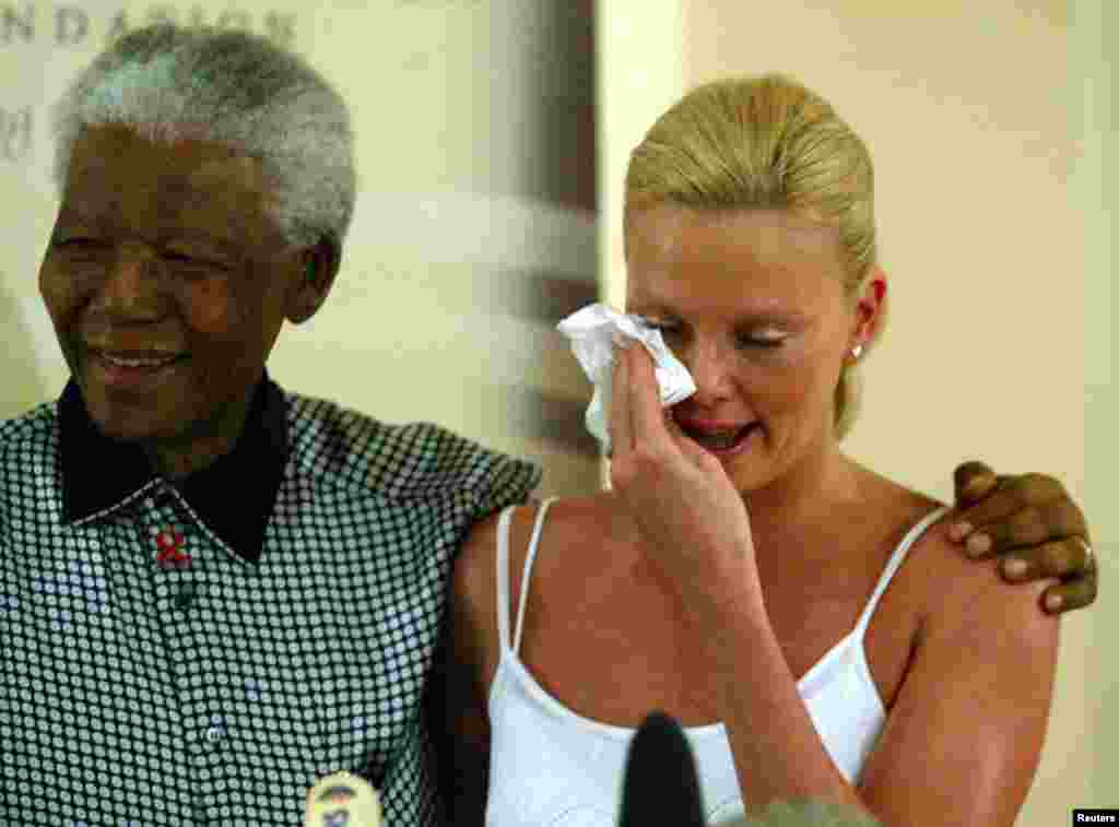 Oscar winning South African actress Charlize Theron weeps at her meeting with former South African President Nelson Mandela at the Nelson Mandela Foundation in Houghton, March 11,2004.