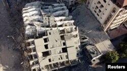 အစ္စရေးလ် လေကြောင်းတိုက်ခိုက်မှုအပြီး ပြိုကျသွားသော အဆောက်အဦးတခု (ဓာတ်ပုံ- Reuters)