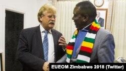 UE Chief Observer Elmar Brok and Zimbabwe President Emmerson Mnangagwa