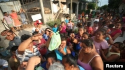 People queue to receive food donations in Juchitan after an earthquake that struck on the southern coast of Mexico, Sept. 9, 2017.