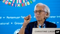FILE - Managing Director of International Monetary Fund (IMF) Christine Lagarde talks during a press conference ahead of the annual meetings of the IMF and World Bank in Bali, Indonesia, Oct. 11, 2018.
