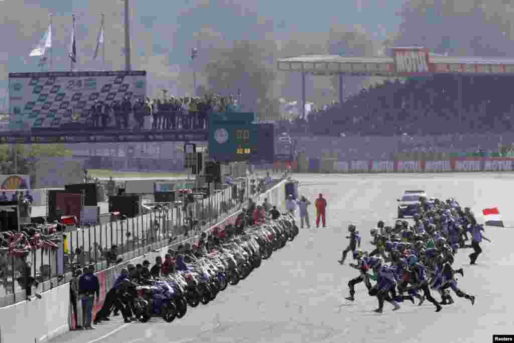 Riders run to their motorbikes at the start of the 36th Le Mans 24 Hours motorcycling endurance race in Le Mans, western France.