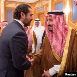 Lebanese Prime Minister Saad Hariri shakes hands with Saudi Arabia's King Salman in Riyadh, Saudi Arabia, Nov. 11, 2017.