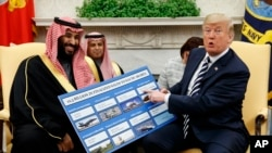 President Donald Trump discusses arms sales to Saudi Arabia during a meeting with Saudi Crown Prince Mohammed bin Salman at the White House, March 20, 2018, in Washington.