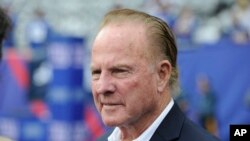 FILE -Former New York Giants player Frank Gifford looks on before an NFL football game between the New York Giants and the Denver Broncos Sunday, Sept. 15, 2013, in East Rutherford, New Jersey.