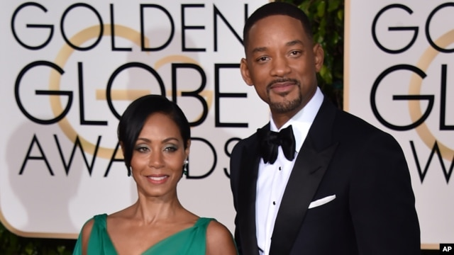 Jada Pinkett Smith, left, and Will Smith arrive at the 73rd annual Golden Globe Awards on Sunday, Jan. 10, 2016, at the Beverly Hilton Hotel in Beverly Hills, Calif. (Photo by Jordan Strauss/Invision/AP)