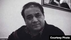被捕前七天的伊力哈木•土赫提。 (王力雄摄)