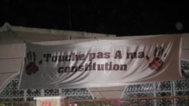 "Senegalese demonstrate against President Wade's decision to run for re-election with signs reading ""Don't touch my constitution!"" (December 2011)"