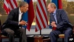 Барак Обама и Владимир Путин. Архивное фото.