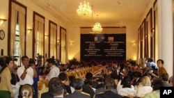 Donors meet with Cambodian government officials in Phnom Penh, in June.