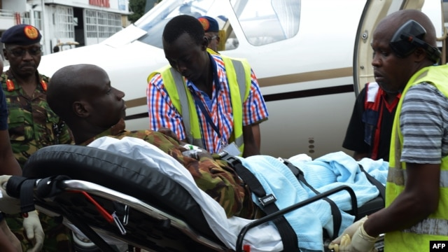 An injured Kenya Defense Force soldier is stretched into an ambulance to be transfered to the hospital after arriving in Nairobi, on Jan. 17, 2016, a day after an attack by the al-Qaeda-linked militants on an African Union base (AMISOM) in southwest Somalia.