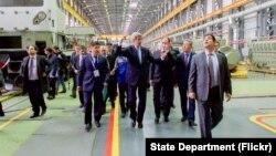 U.S. Secretary of State John Kerry walks through the Locomotive Plant during a tour in Astana, Kazakhstan on Nov. 2, 2015.