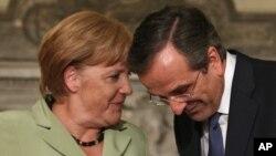 Kanselir Jerman Angela Merkel mengadakan pertemuan dengan PM Yunani Antonis Samaras di Athena (9/10).