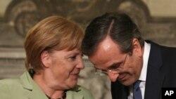 Nemačka kancelarka Angela Merkel i grčki premijer Antonis Samaras prilikom ranijeg susreta u Atini (arhivski snimak)