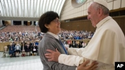 Pope Francis hugs Sister Carmen Sammut, a Missionary Sister of Our Lady of Africa at the end of a special audience with members of the International Union of Superiors General in the Paul VI Hall at the Vatican, May 12, 2016.