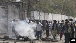 Residents at the scene of a suicide attack in Mogadishu, Oct. 4, 2011.