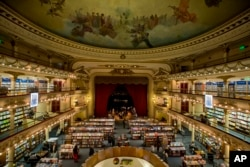 Customers walk around the El Ateneo Grand Splendid bookstore located in a former theater in Buenos Aires, Argentina.