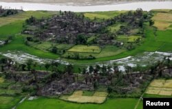 FILE - Aerial view of a burned Rohingya village near Maungdaw, north of Rakhine State, Myanmar, Sept. 27, 2017.