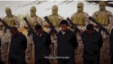 FILE - Islamic State militants stand behind what are said to be Ethiopian Christians in Libya, in this still image from an undated video posted to a social media website on April 19, 2015.