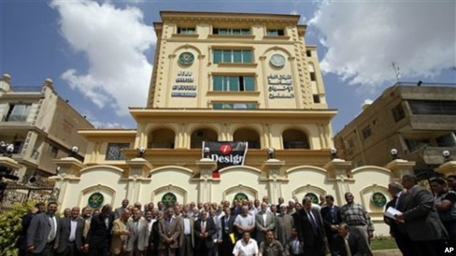 Egyptian Muslim Brotherhood Shura (Consultative) council members gather for a photo op outside the new Muslim Brotherhood headquarters in Cairo, April 30, 2011